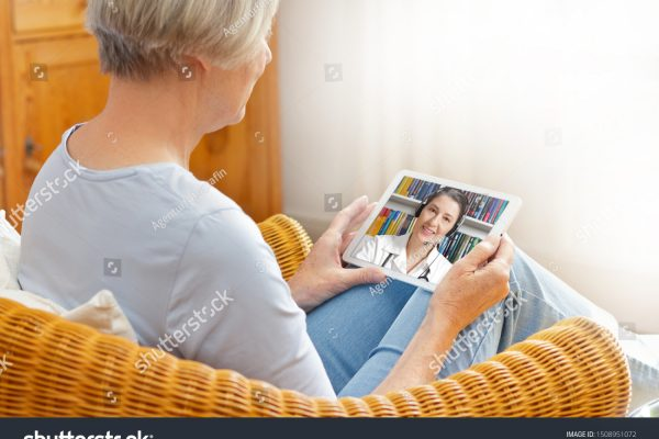 stock-photo-telemedicine-concept-old-woman-with-tablet-pc-during-an-online-consultation-with-her-doctor-in-her-1508951072